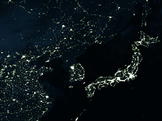 North Korea at night in the dark hungry for power to light up the grid DPRK